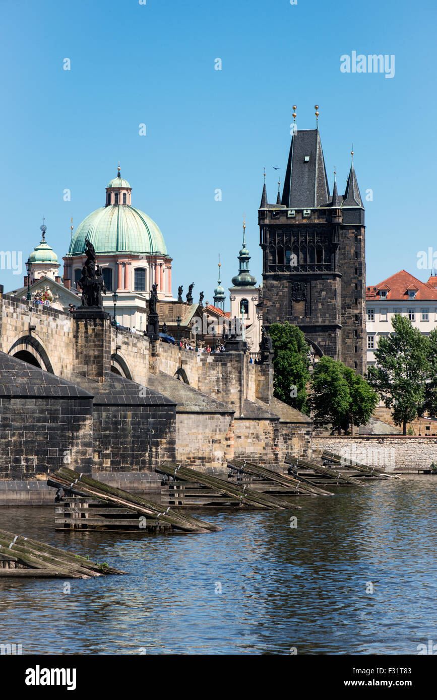 View of colorful old town and Charles Bridge with river Vltava, Prague, Czech Republic - Stock Image