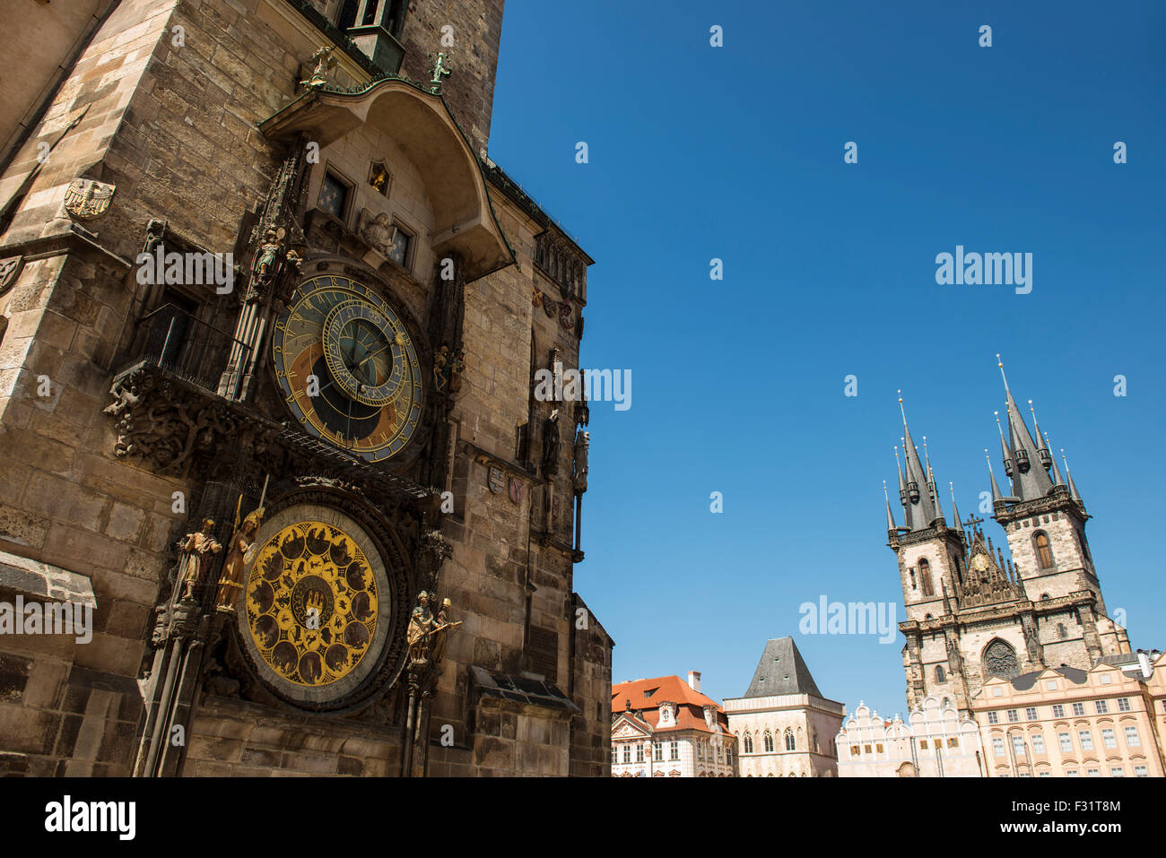 Old astronomical clock (Prague Orloj) in Old Town Square with Church of our lady before Tyn, Prague, Bohemia, Czech - Stock Image