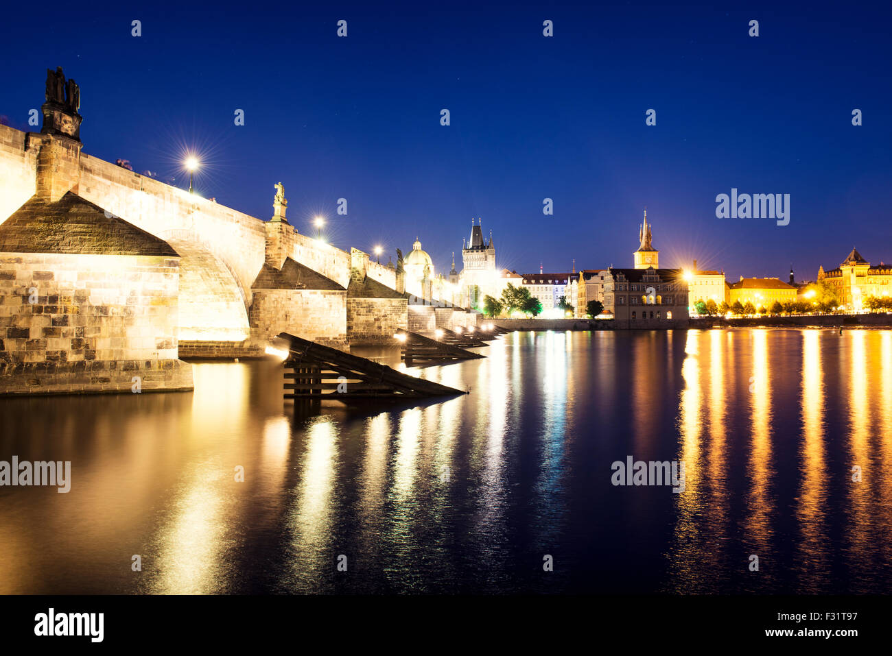 Night view of colorful old town and Charles Bridge with river Vltava, Prague, Czech Republic - Stock Image