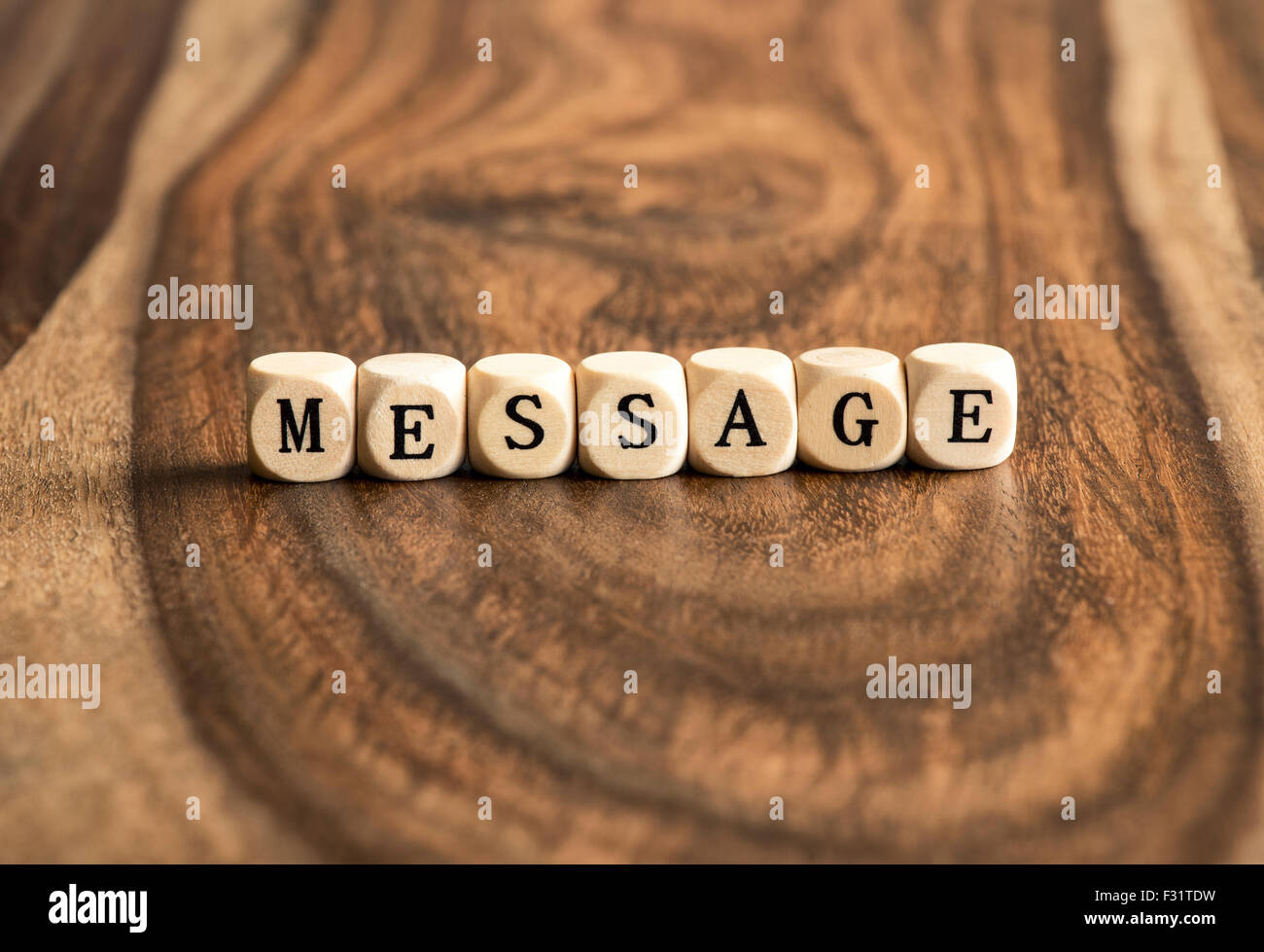 MESSAGE word background on wood blocks - Stock Image