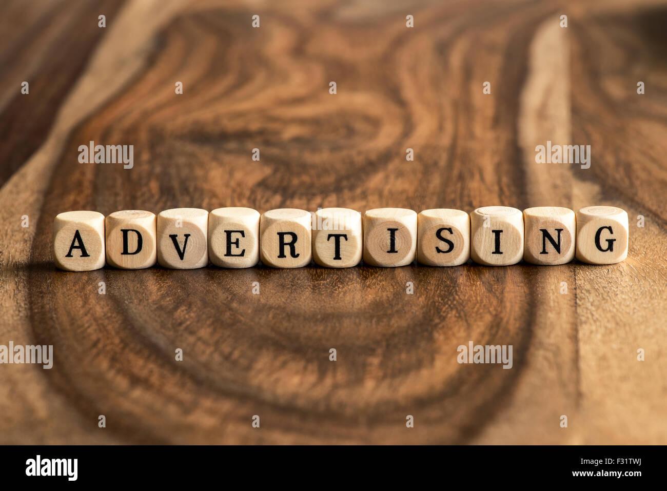 ADVERTISING word background on wood blocks - Stock Image