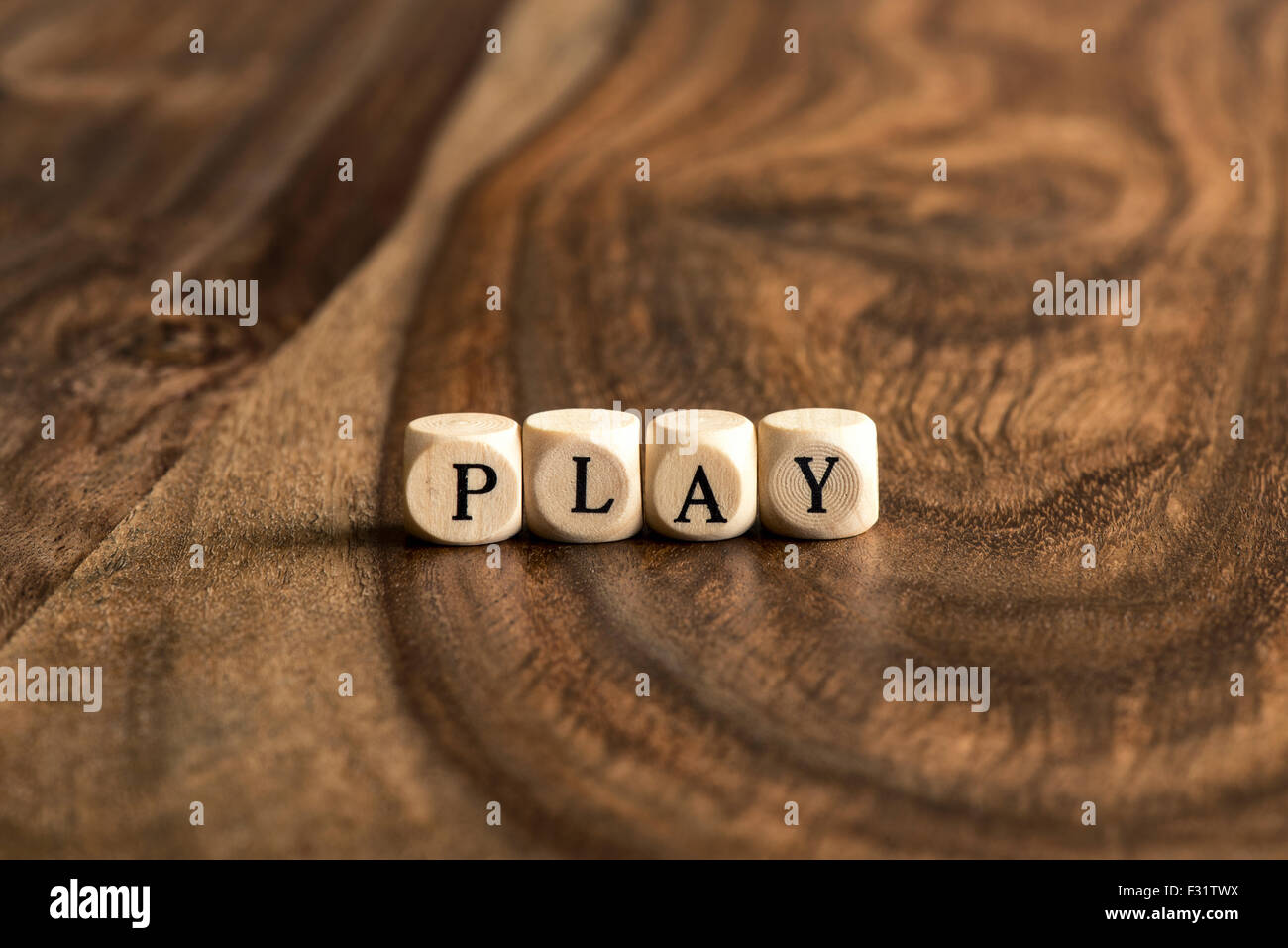 PLAY word background on wood blocks - Stock Image