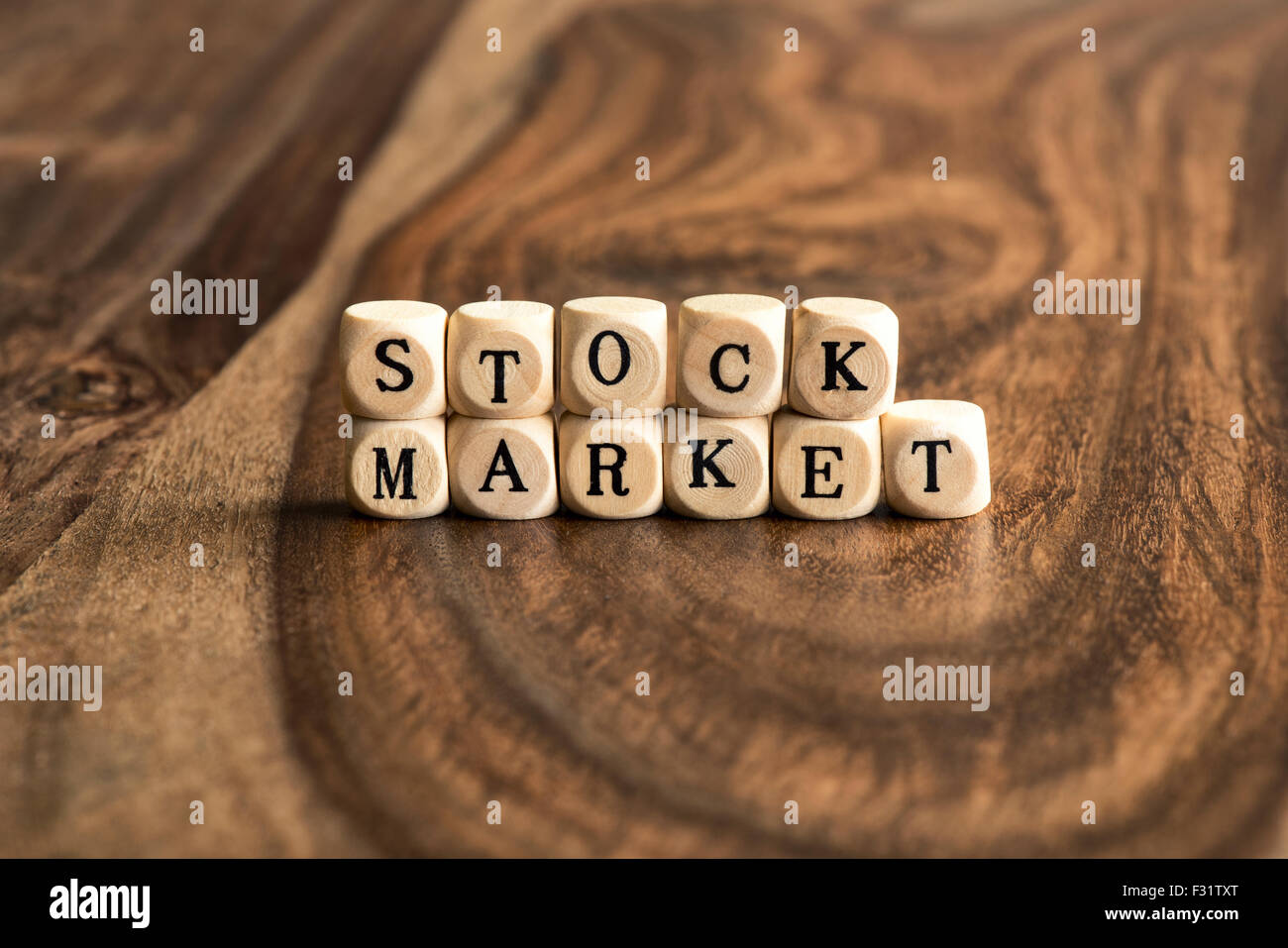 STOCK MARKET word background on wood blocks - Stock Image