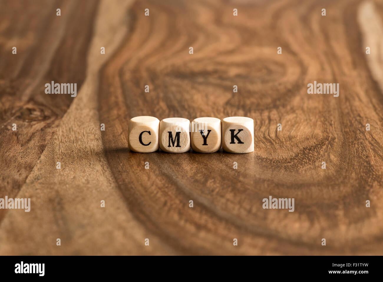 CMYK word background on wood blocks - Stock Image