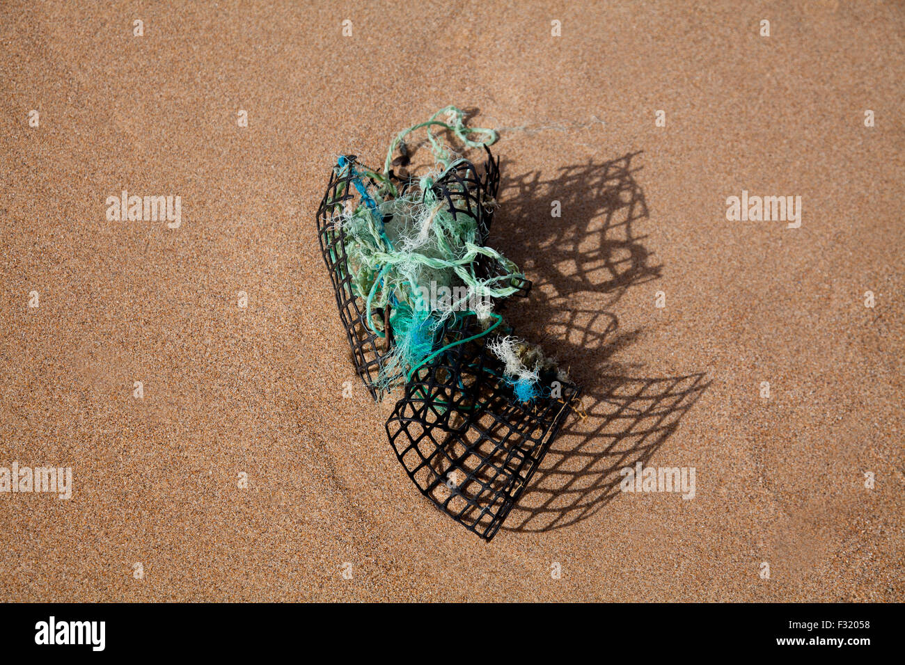 Plastic debris on a beach. - Stock Image