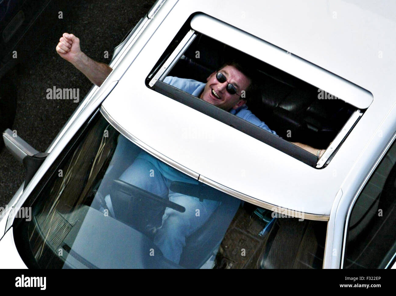 elated man looking up through his car sunroof credit image jack stock photo 87941694 alamy. Black Bedroom Furniture Sets. Home Design Ideas