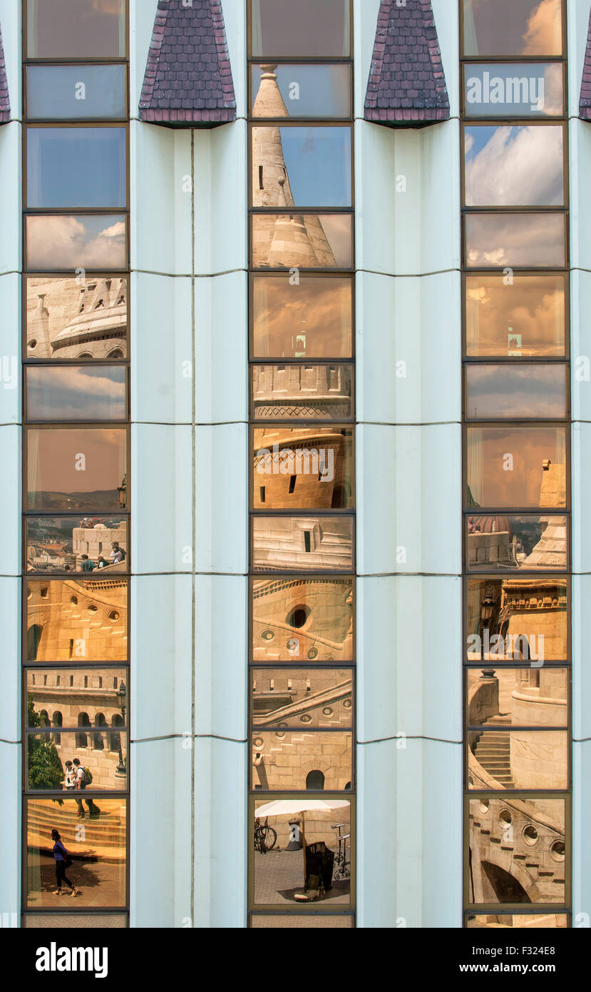 Fishermans Bastion reflected in the windows of the Hilton Hotel, castle hill, Budapest, Hungary - Stock Image