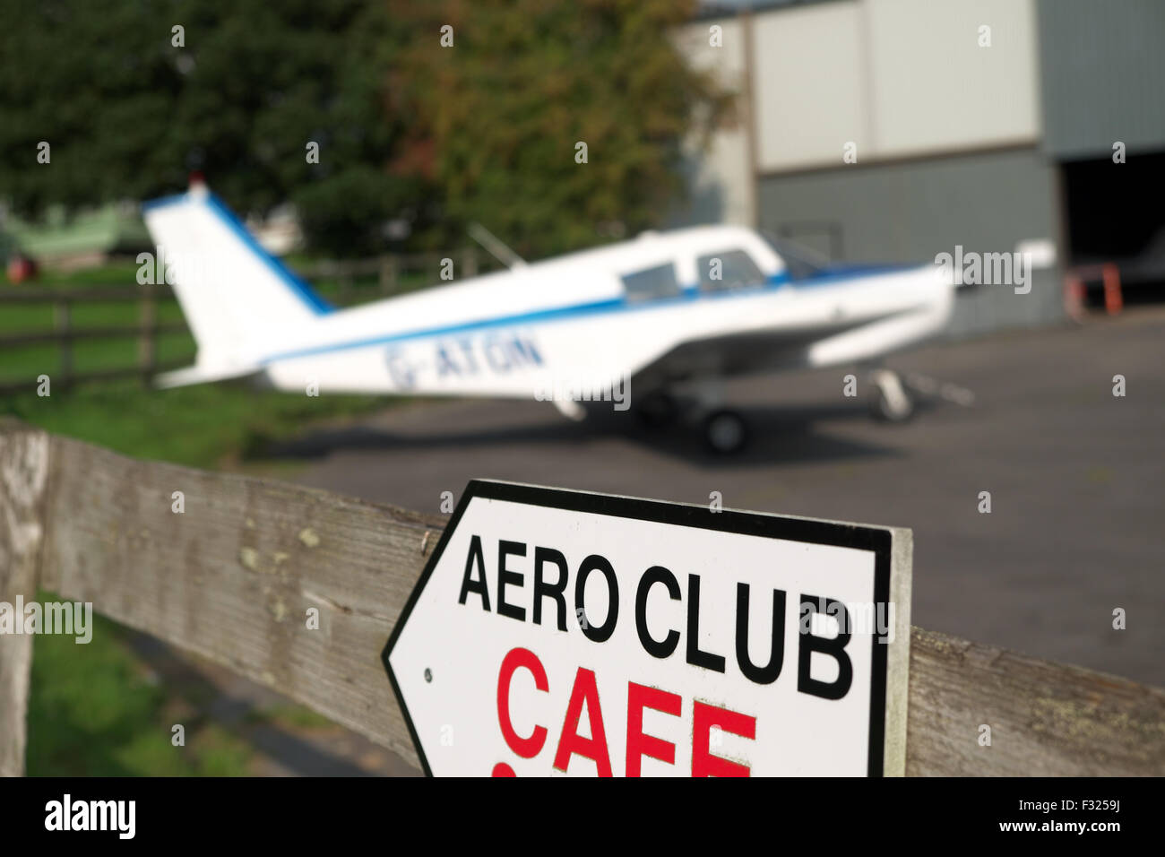 Aero Club flying club a Piper Pa-28 Cherokee parked on the apron outside a hangar at a small airfield in UK - Stock Image
