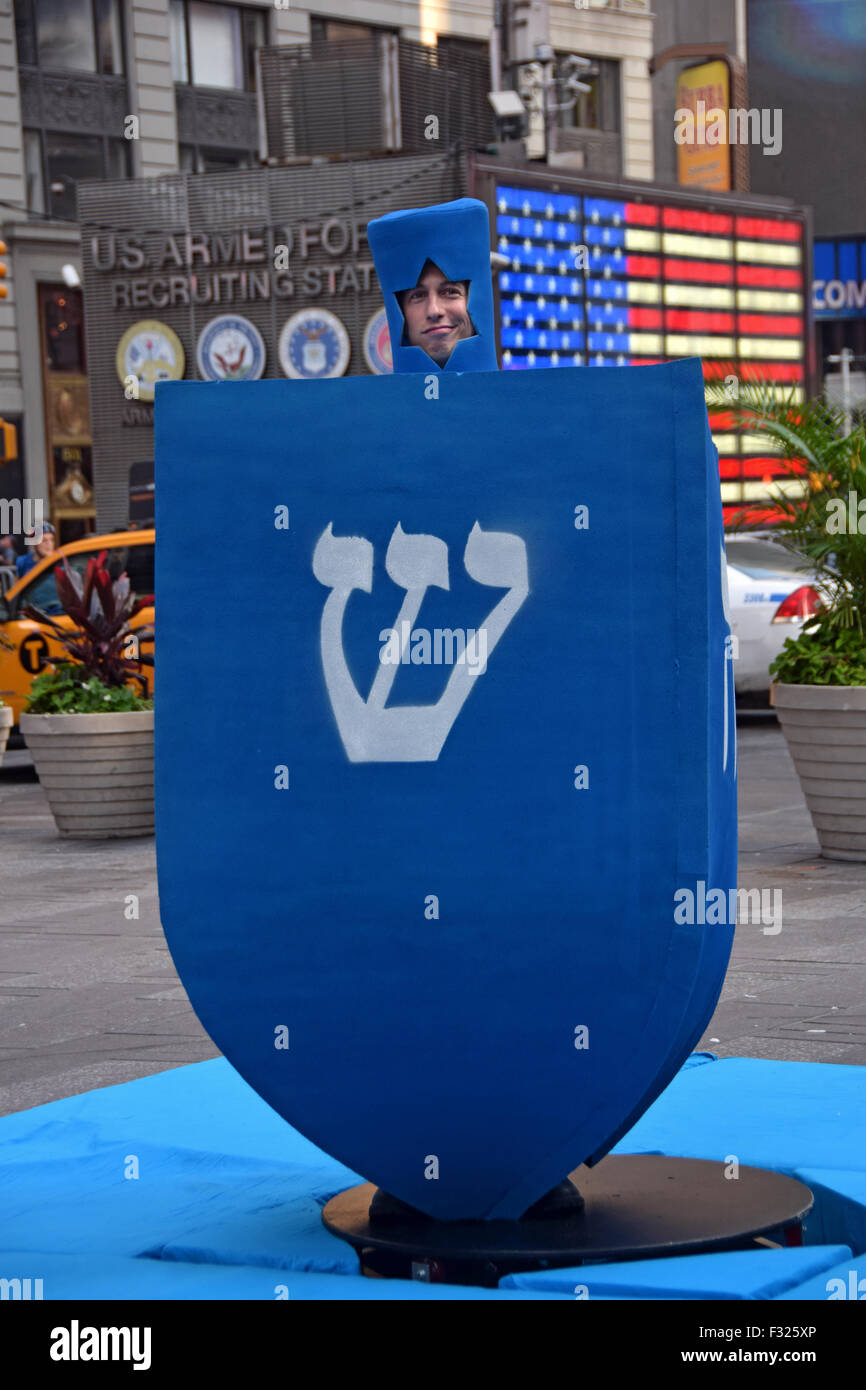 MTV filming a holiday segment with a giant Chanukkah dreidel. In Times Square, New York City. Stock Photo