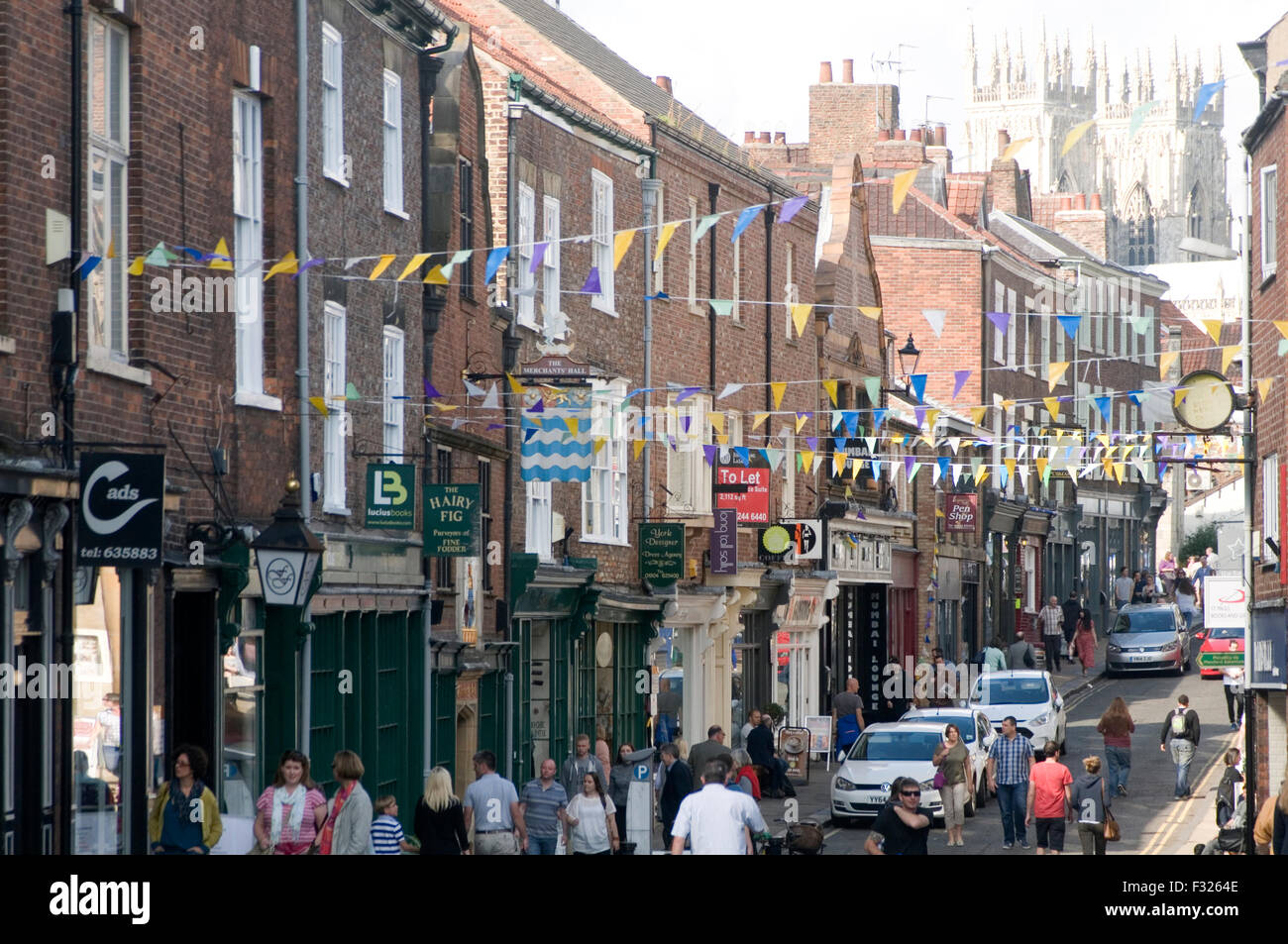 fossgate street in York town center uk minster people shoppers shopping - Stock Image