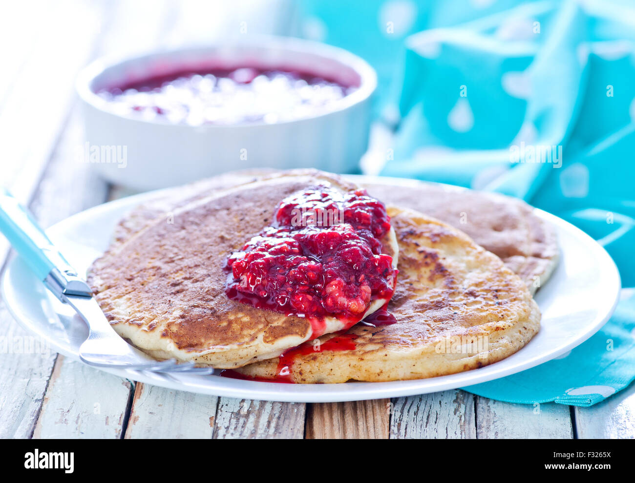 sweet pancakes with jam on the plate - Stock Image