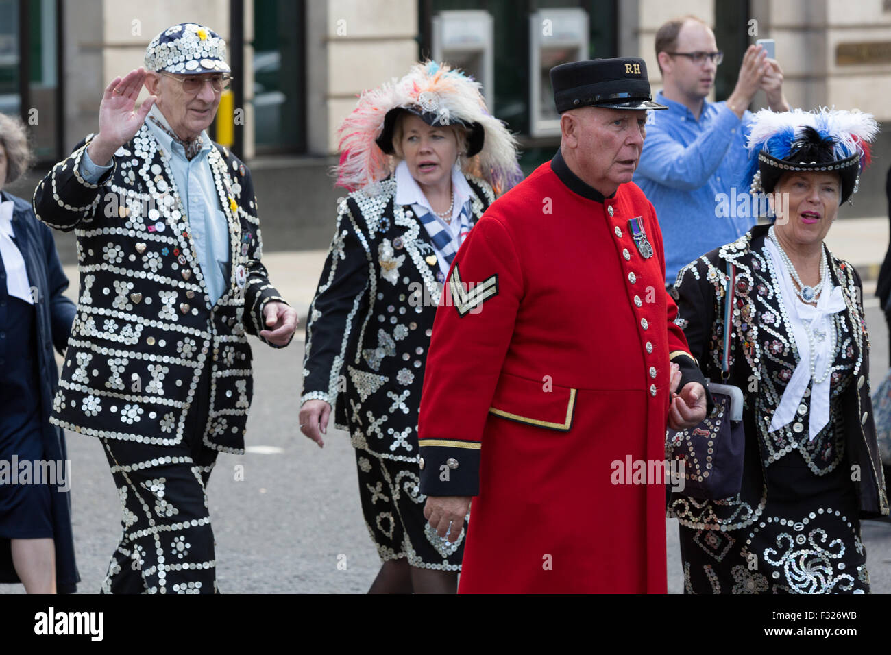 Pearly Kings and Queens celebrate the harvest festival, wearing their traditional pearl-button suits as they parade Stock Photo