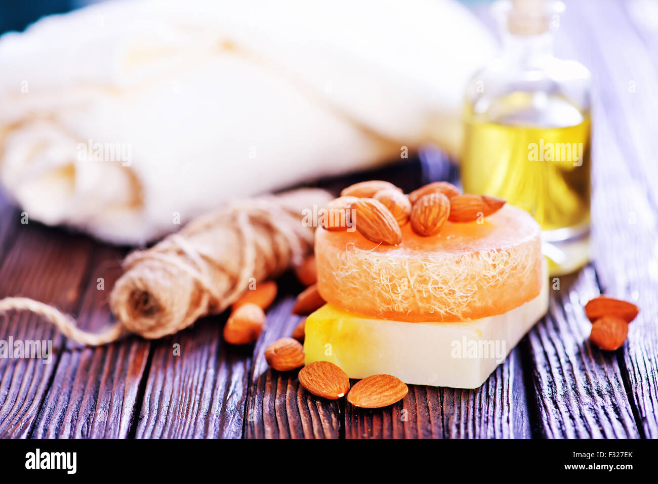 almond soap and oil on the wooden table - Stock Image
