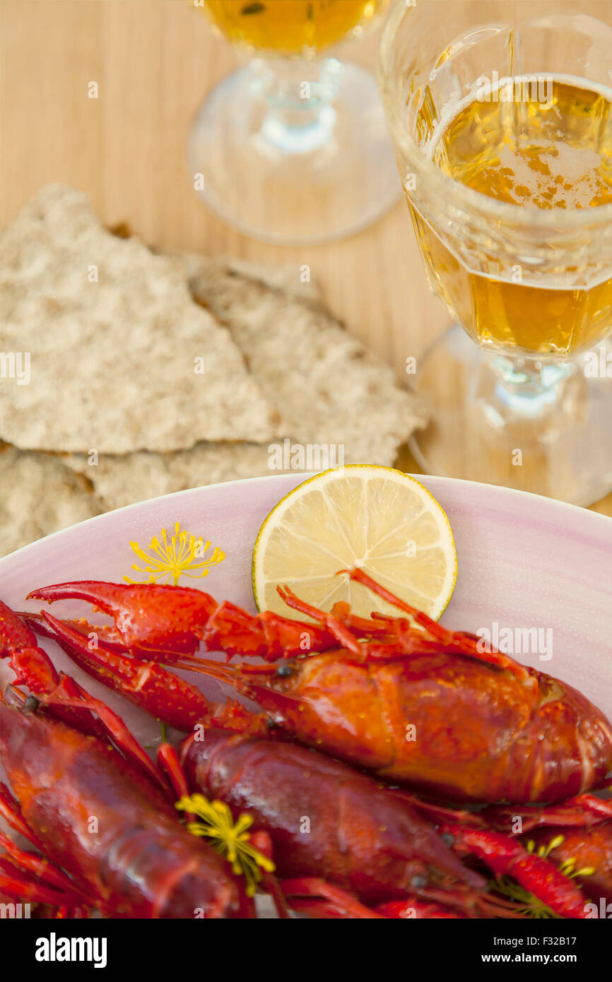 Image of a crayfish dinner, with beer and crisp bread. - Stock Image