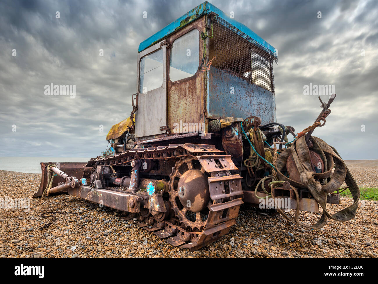 Old rusty bulldozer used for launching fishing boats - Stock Image