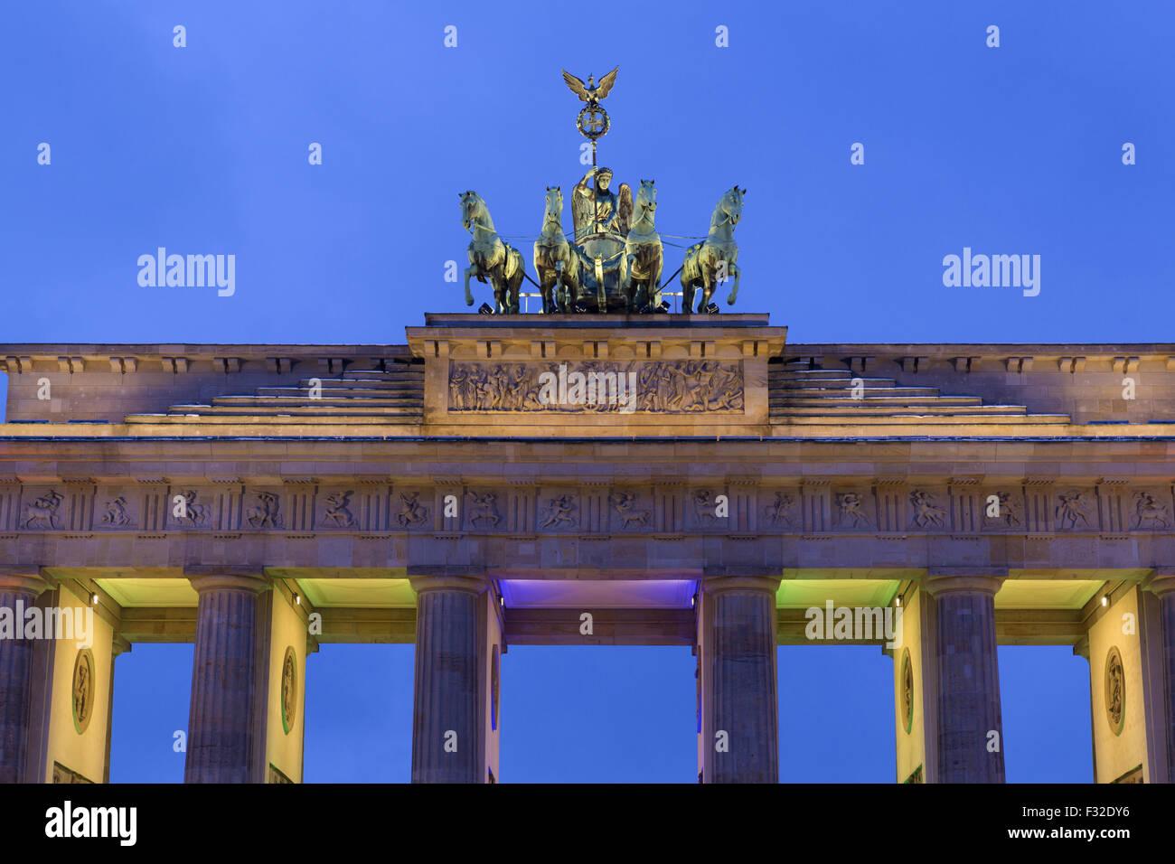 Quadriga on 18th century neoclassical triumphal arch at night, Brandenburg Gate, Berlin, Germany, January - Stock Image