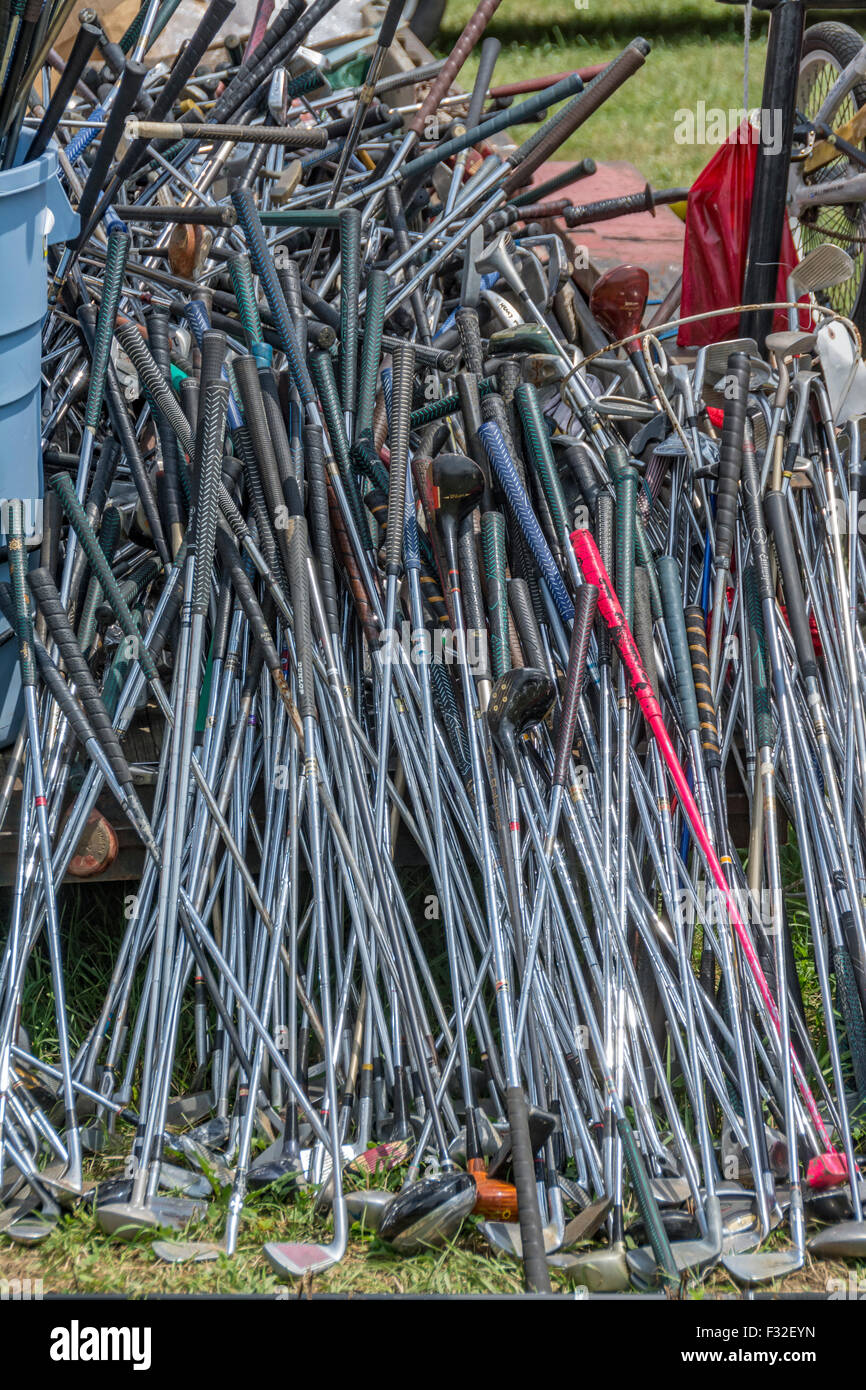 Stack of used golf clubs at the Highway 127 Yard Sale in