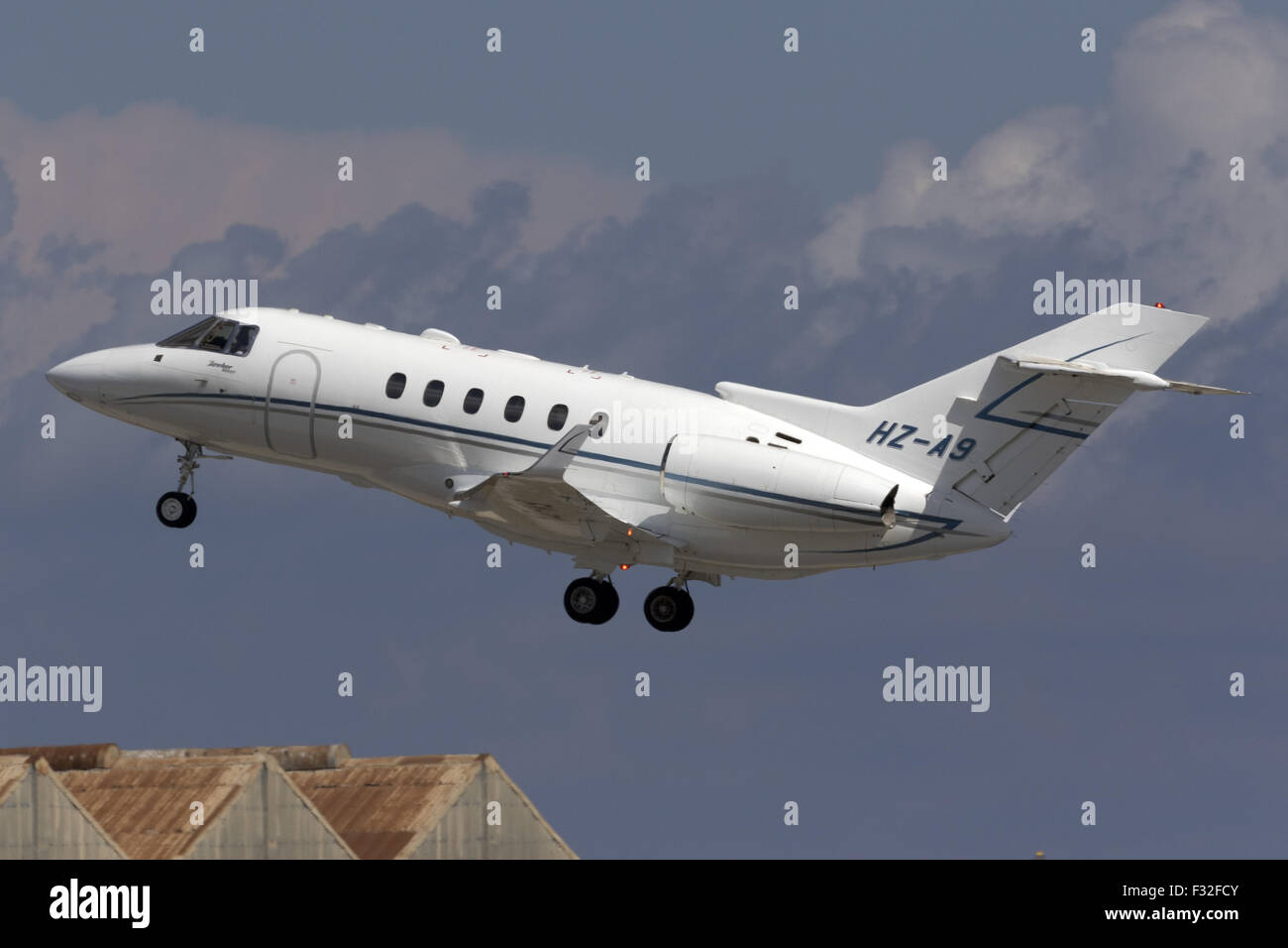 A Private Hawker 800XP taking off from runway 31. - Stock Image