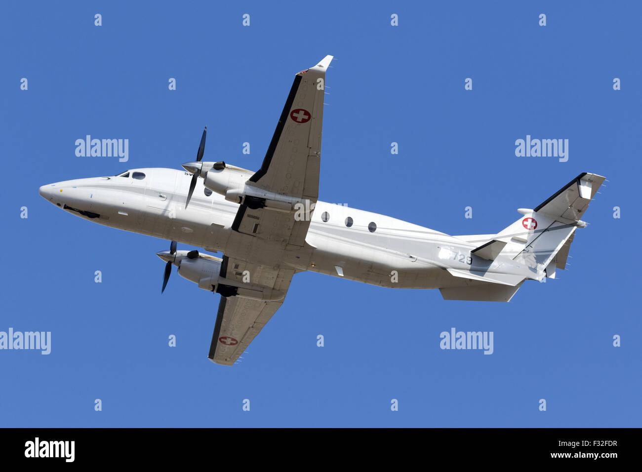 Switzerland Air Force Raytheon 1900D taking off runway 23. - Stock Image