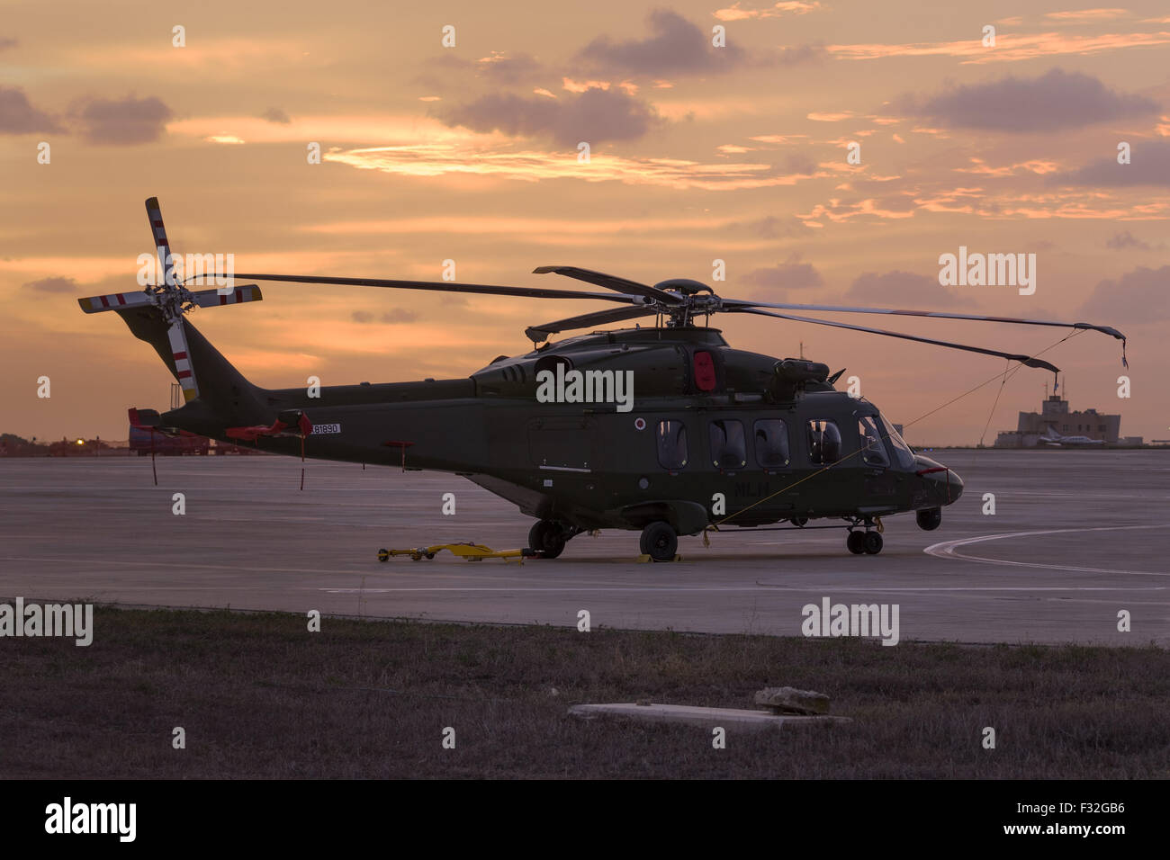 Italian Agusta Westland AW-189 parked in apron 4, ready for the airshow in the sunrise. - Stock Image