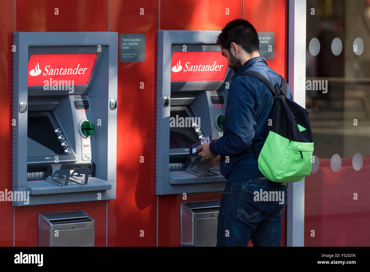 A Santander cash point (ATM) on the high street. - Stock Image