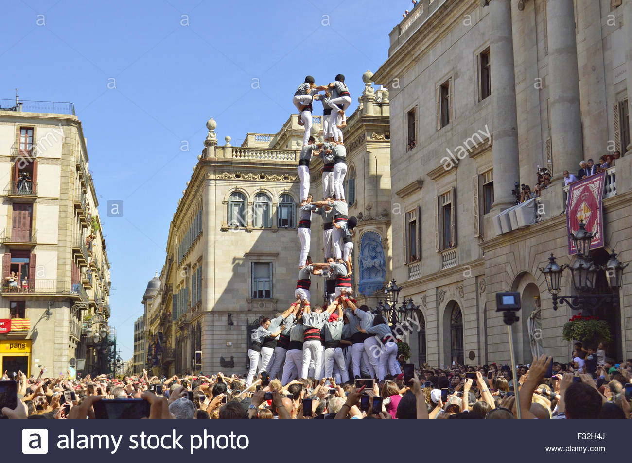 Team of acrobats building 'Human Pyramid' (Castell) during 'La Merce' annual street festival in - Stock Image