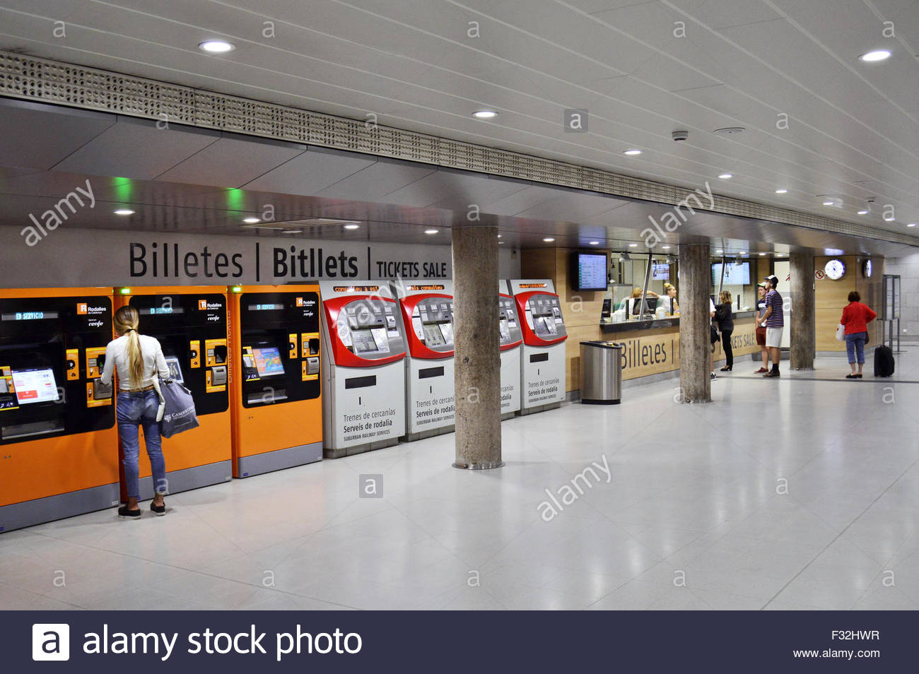 Purchasing metro tickets from automated vending machines and ticket office in Barcelona Spain Europe Stock Photo