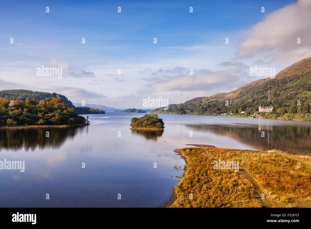 Loch Awe, and a distant view to the Loch Awe Hotel, Argyll and Bute, Scotland, UK. - Stock Image