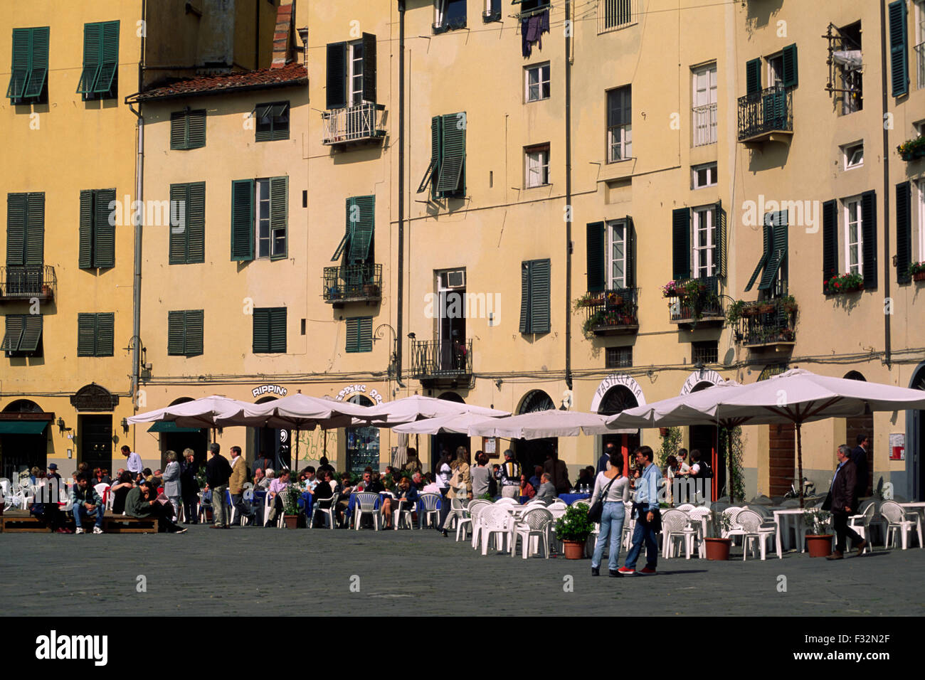 lucca, tuscany, italy, cafes in piazza del mercato (built on the foundations of the roman amphitheatre) Stock Photo