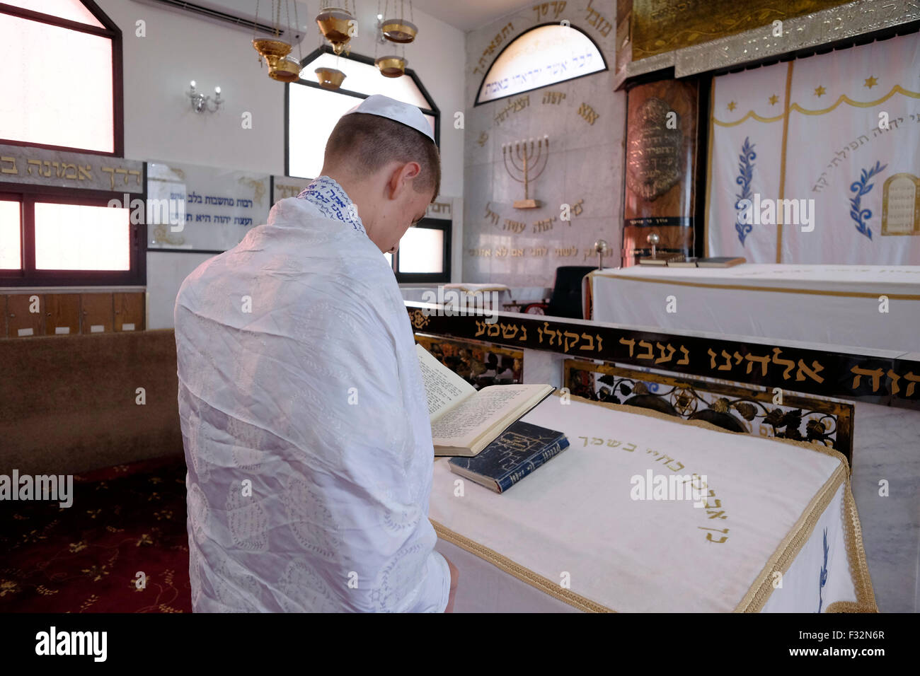 A Karaite Jew praying in a Karaite synagogue in the city of Ramle or Ramleh Israel Stock Photo