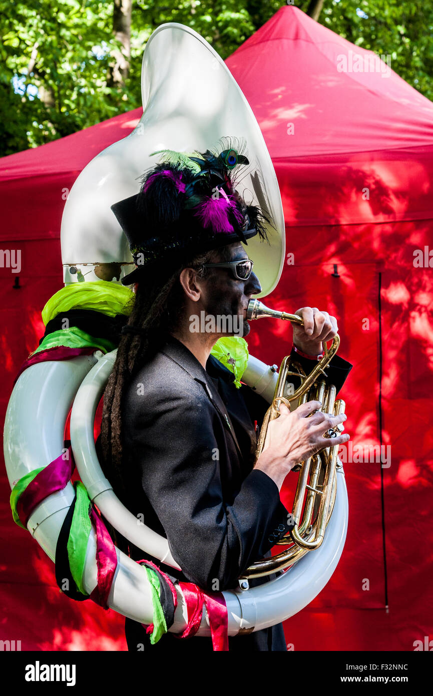 Beorma Border Morris dancer in costume with his sousaphone Stock Photo