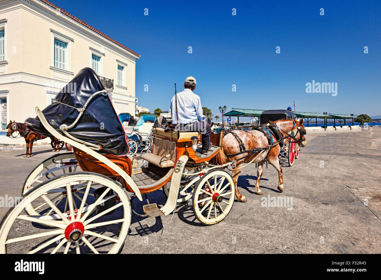 A horse drawn carriage in the city of Spetses island, Greece - Stock Image
