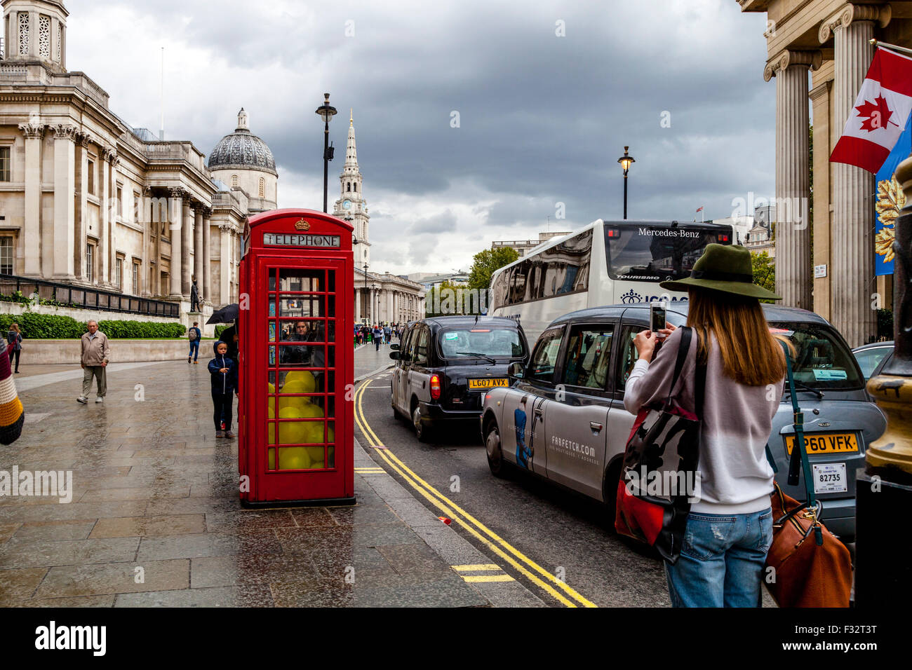 A Traditional Red Telephone Box Outside The National Gallery, London, UK - Stock Image