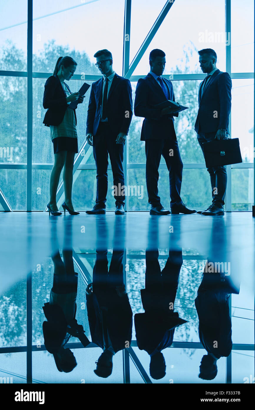 Business people planning work and consulting at meeting - Stock Image