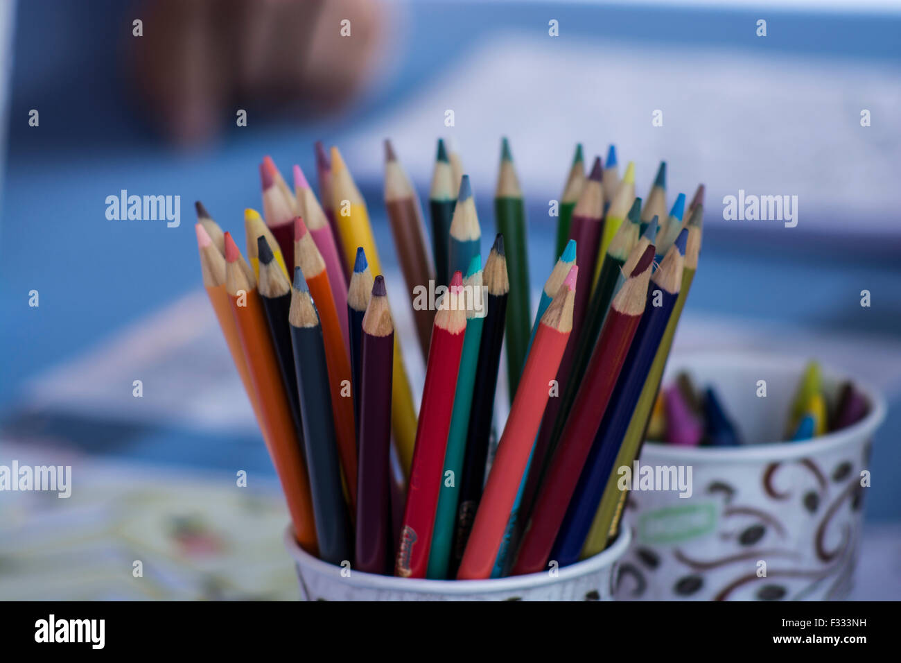 A cup of colored pencils; arts and crafts are part of the festivities at the Irvine Global Village Festival - Stock Image