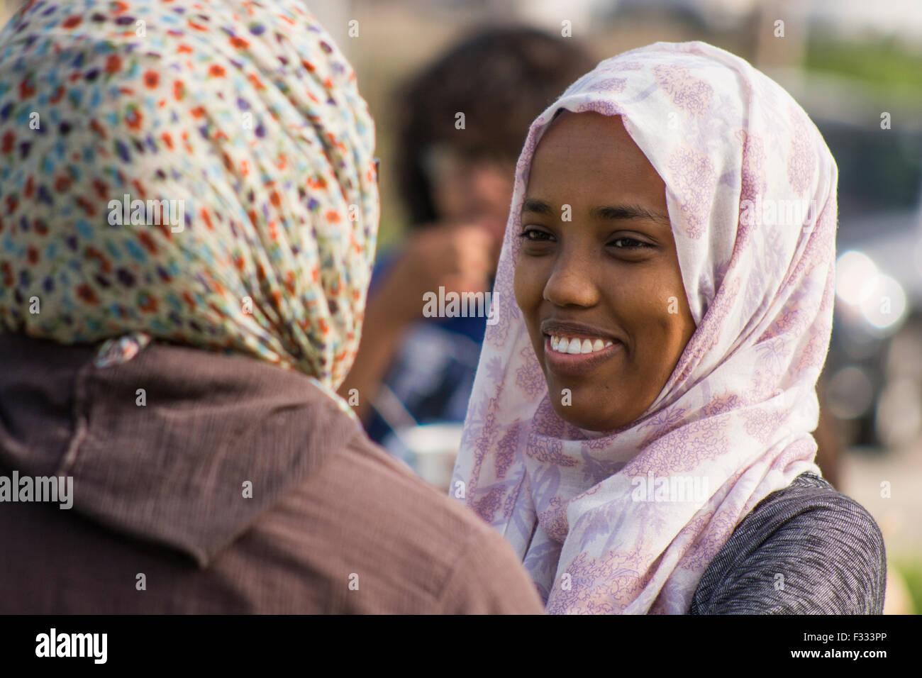 Two Muslim women wearing a Hijab. - Stock Image