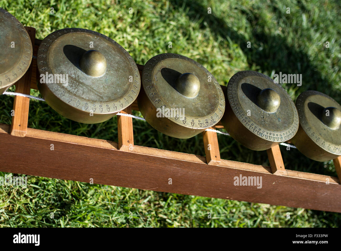 A row of gongs with the modern term being Kulintang. - Stock Image