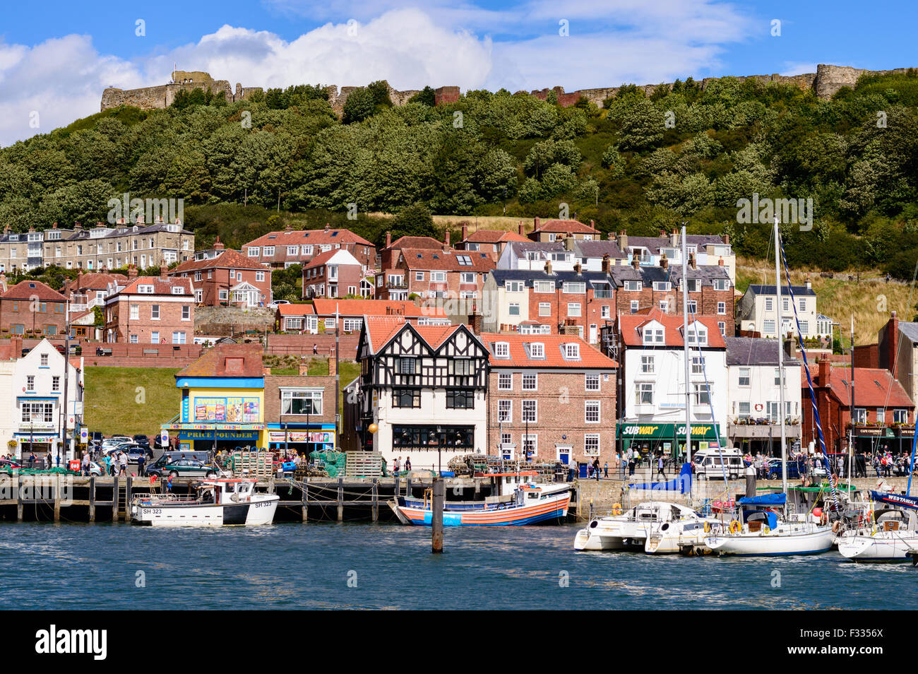Scarborough castle, and fishing harbour - Stock Image