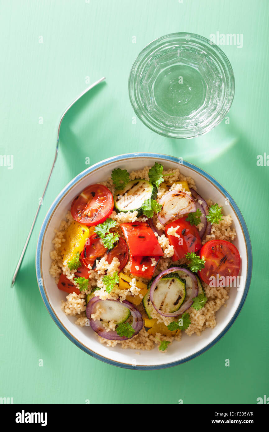 healthy couscous salad with grilled tomato pepper zucchini onion - Stock Image