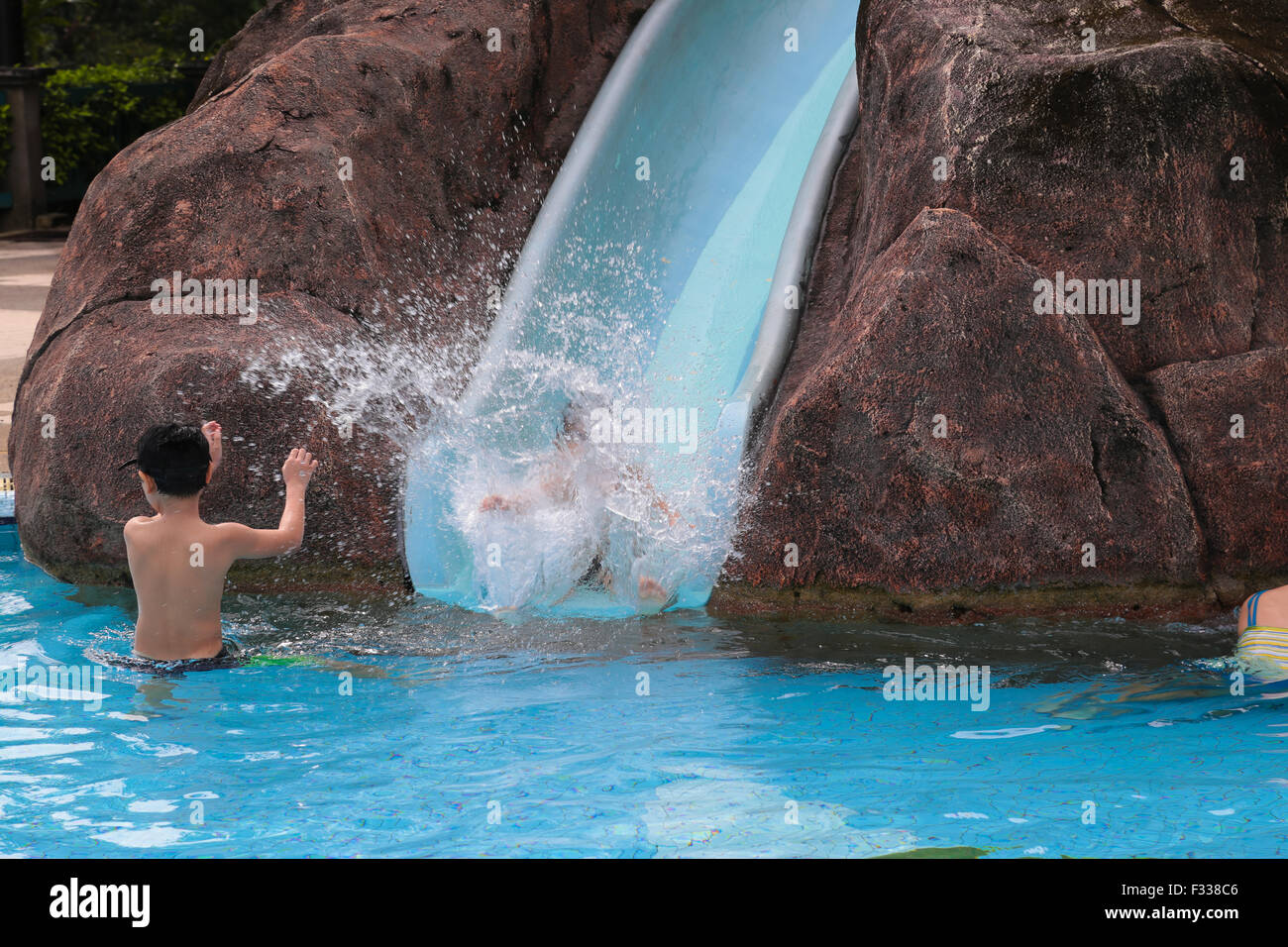 Wet girl malaysia stock photos wet girl malaysia stock images alamy for Local swimming pools with slides