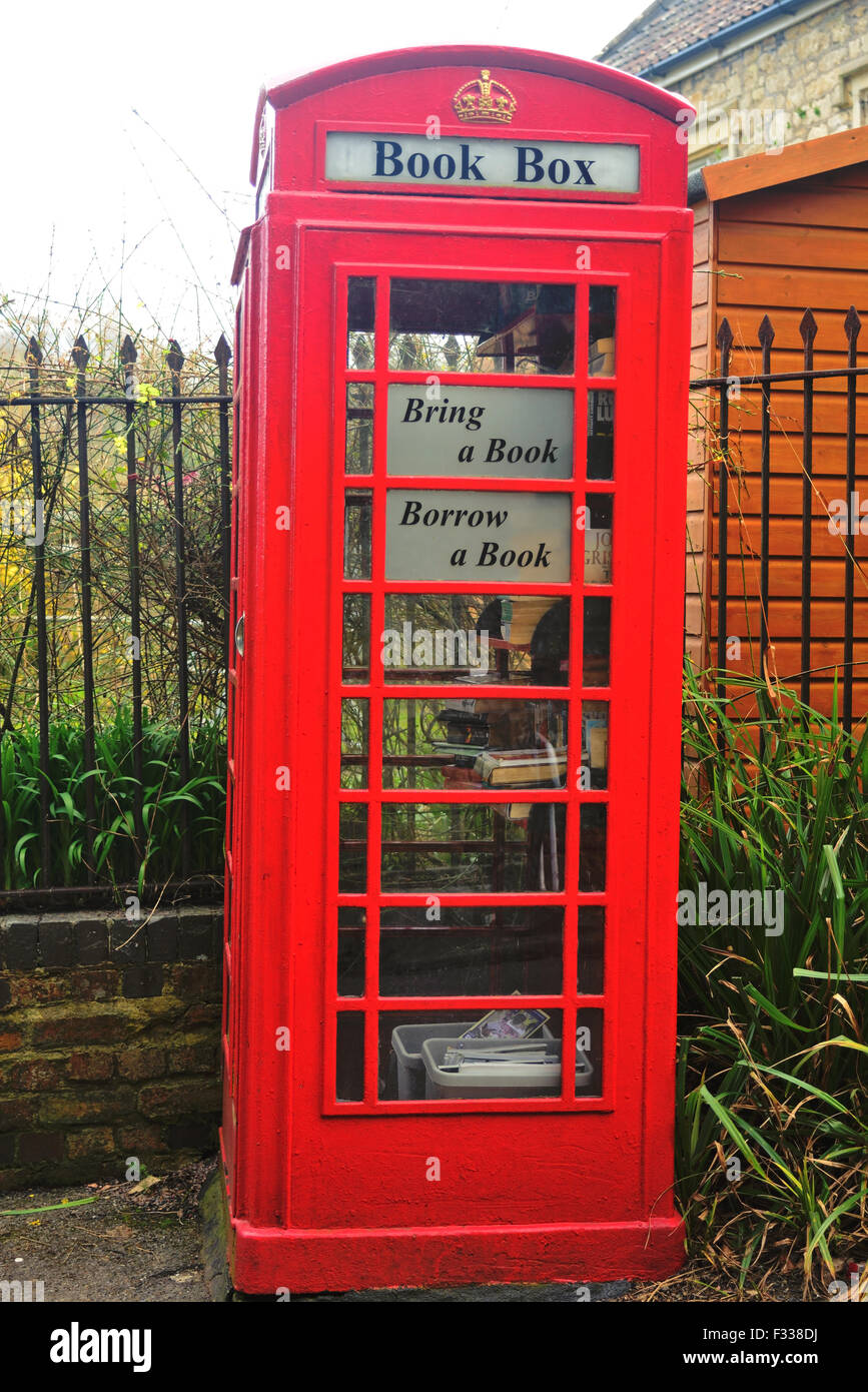 Red telephone box now used as a book exchange. - Stock Image