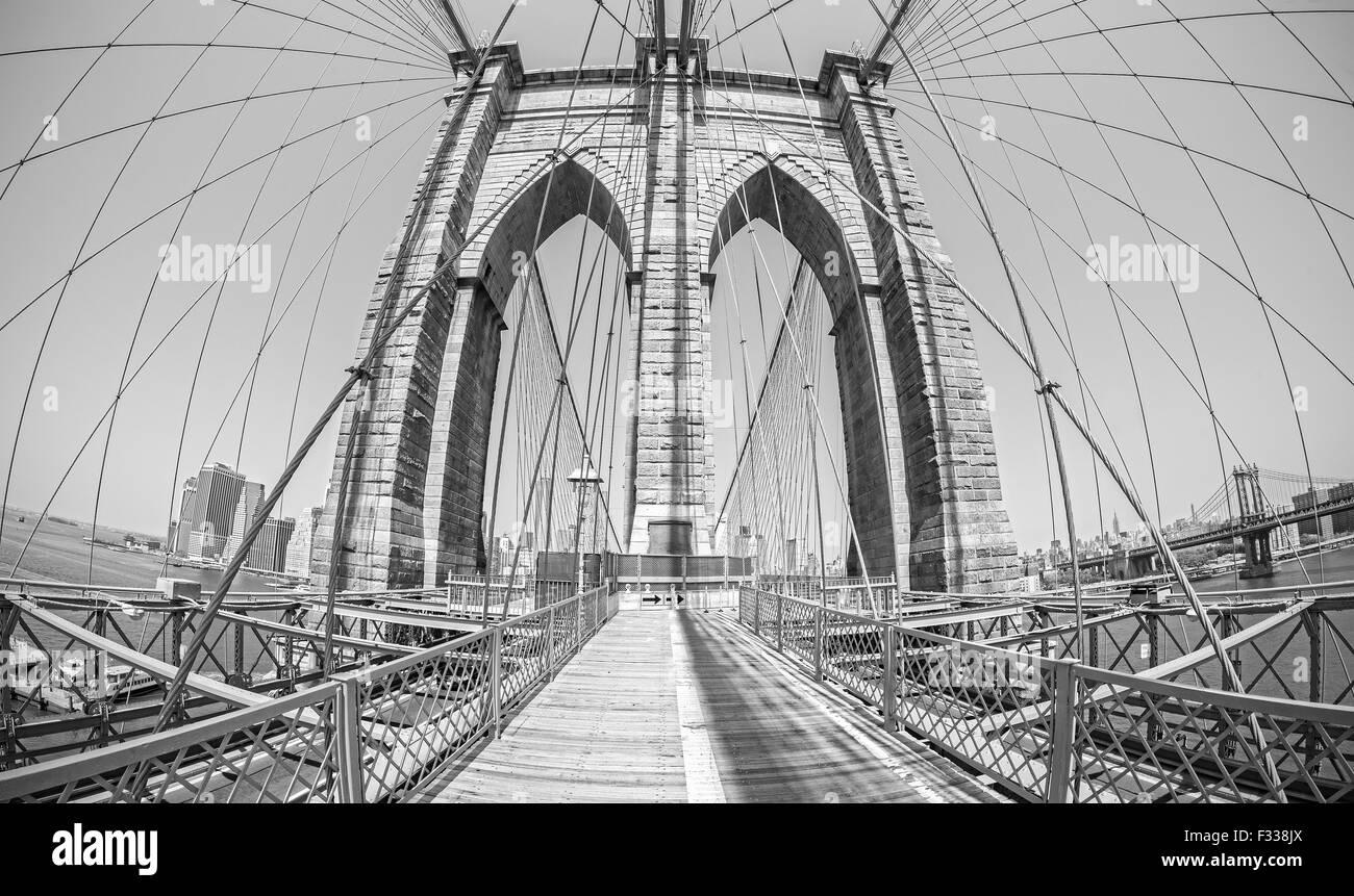 Brooklyn Bridge in fisheye lens, old film black and white style, NYC, USA. - Stock Image