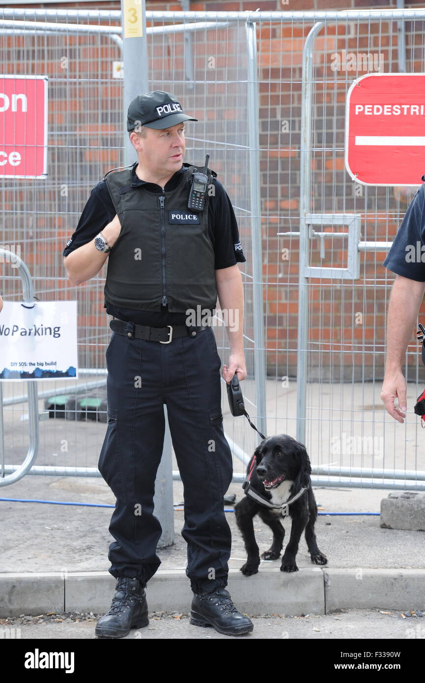 A Greater Manchester Police Dog Handler with his search dog. - Stock Image
