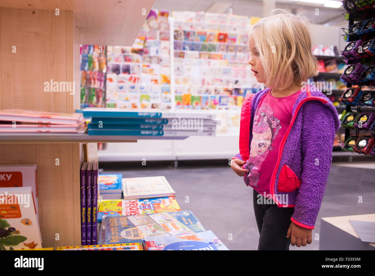 shopping for school supplies in a supermarket, educational stationery department - Stock Image