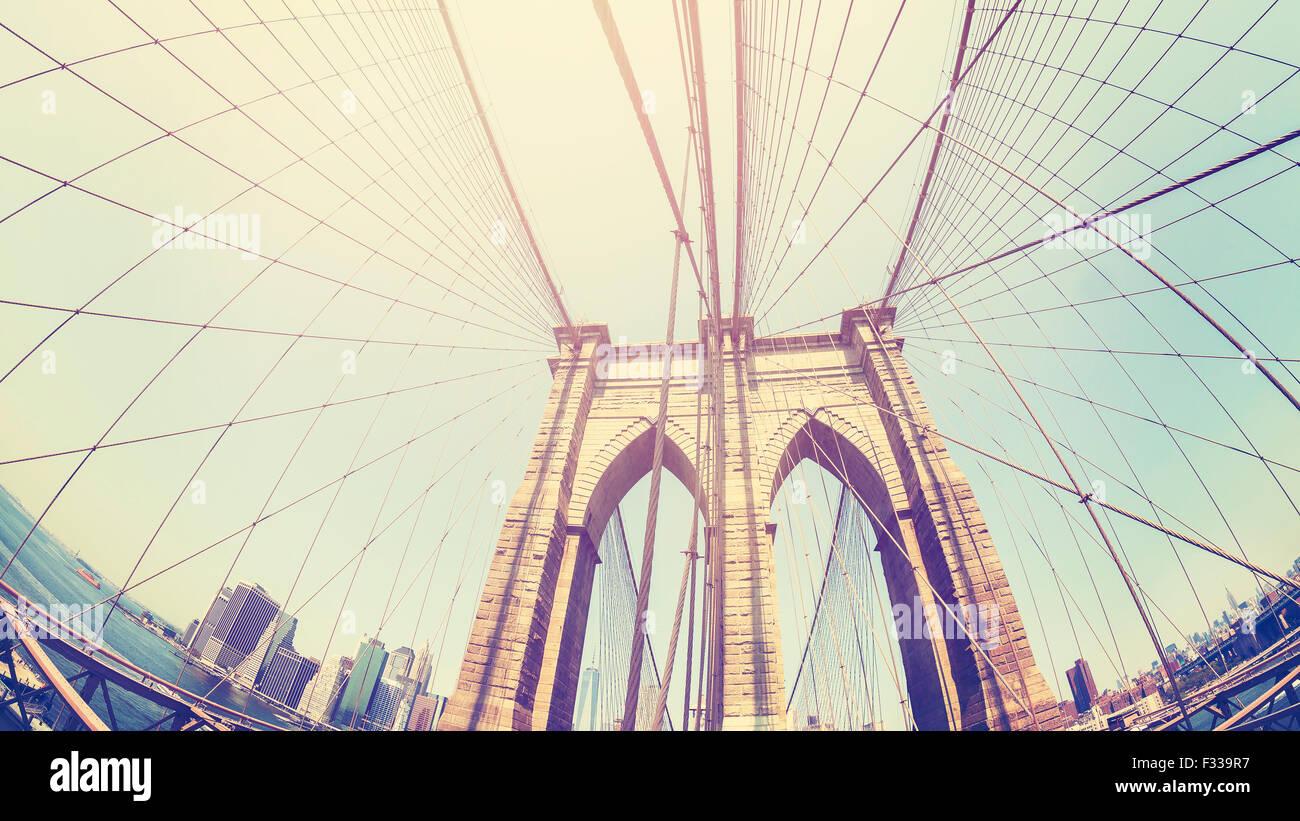 Retro stylized photo of Brooklyn Bridge, fisheye lens, NYC, USA. - Stock Image