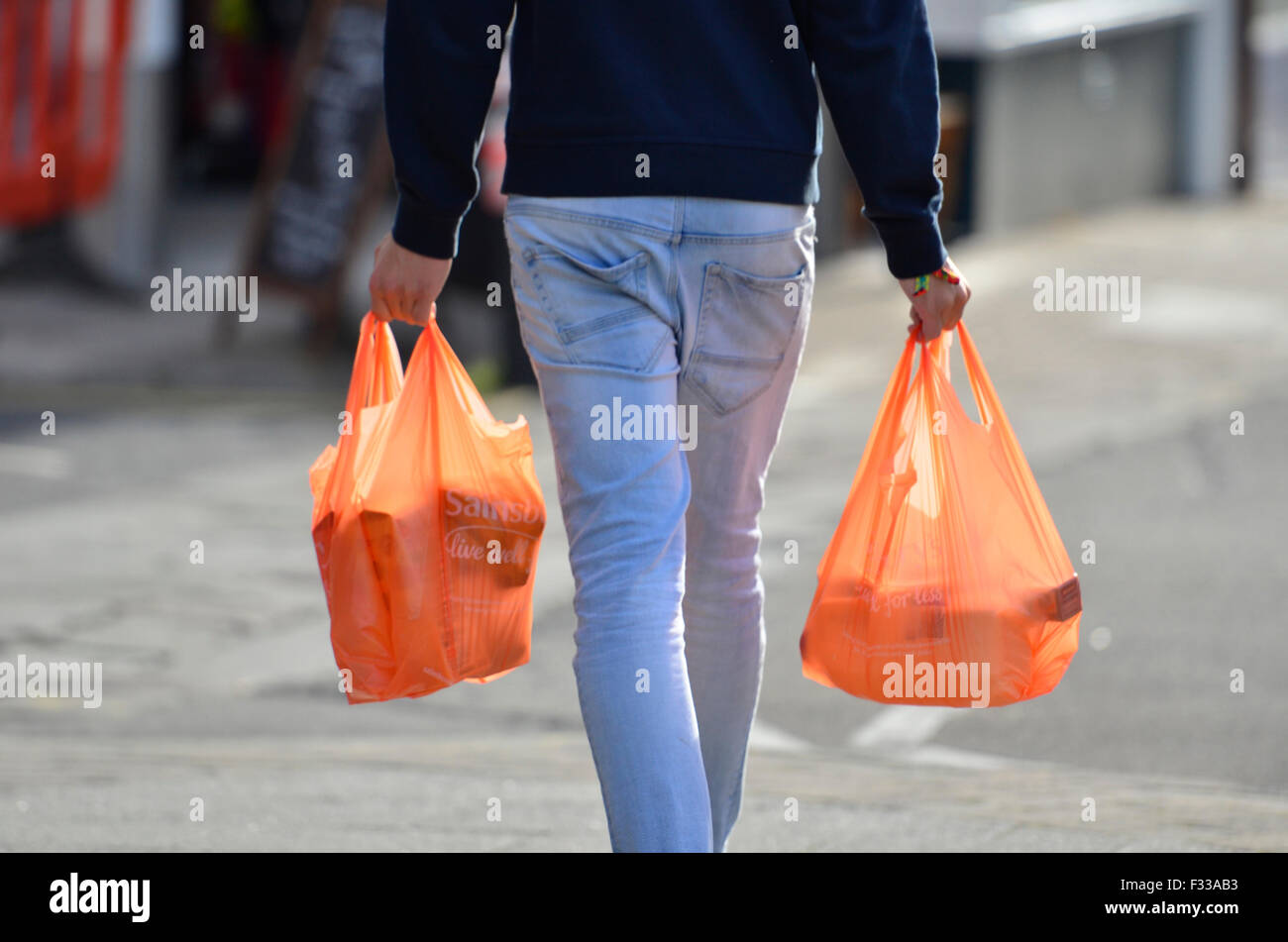 Bristol, UK. 29th Sep, 2015. All users of plastic bags for collecting their shopping will be charged 5p from Next - Stock Image