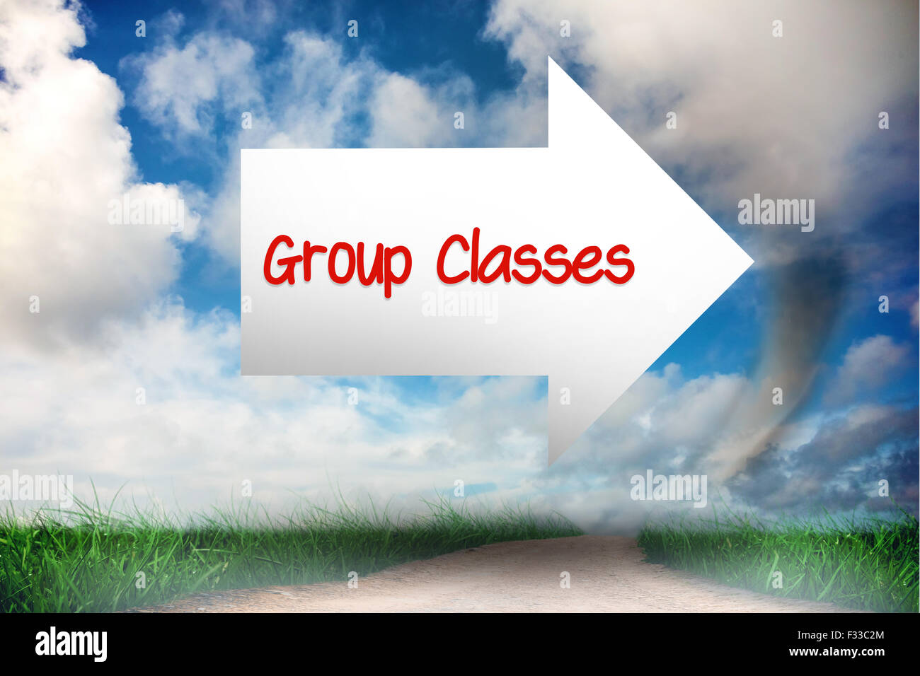 Group classes against road leading out to the horizon - Stock Image