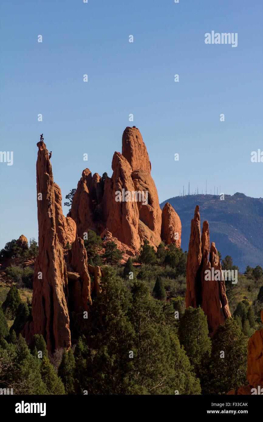 Climber on the top of a rock in the Garden of the Gods park, Colorado Springs, Colorado, USA Stock Photo