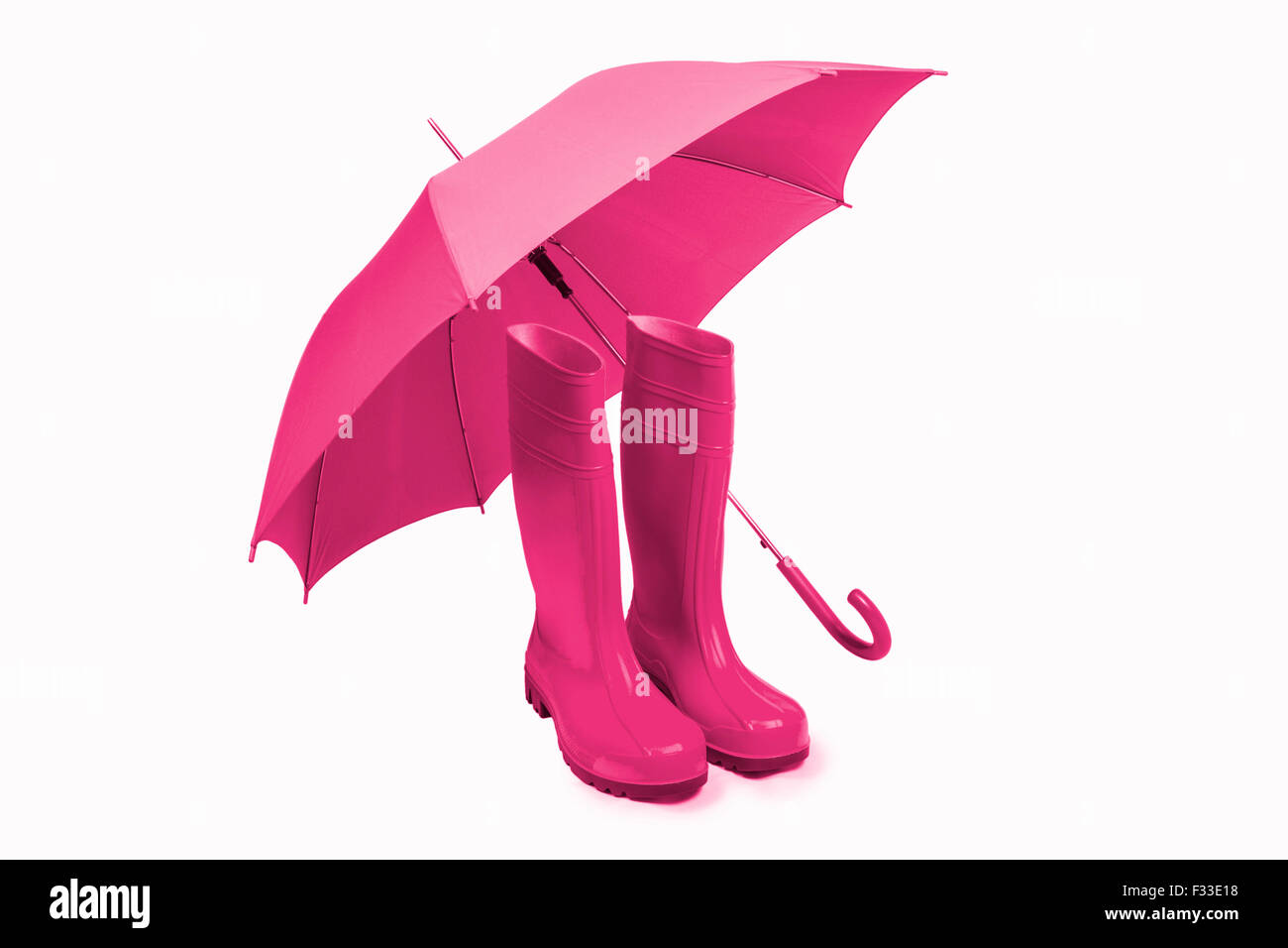 Pink rubber boots and umbrella isolated Stock Photo