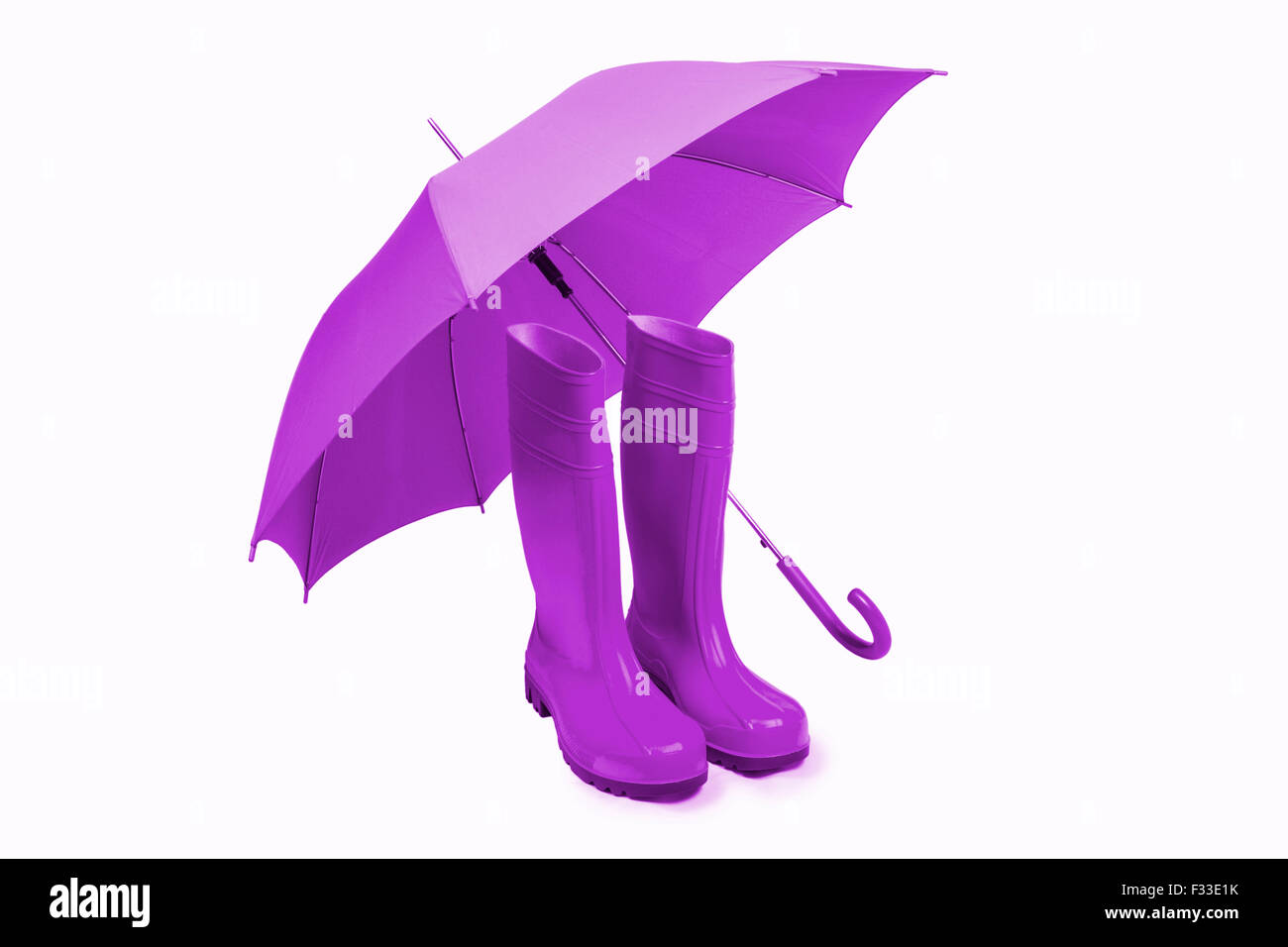 Violet rubber boots and umbrella isolated Stock Photo